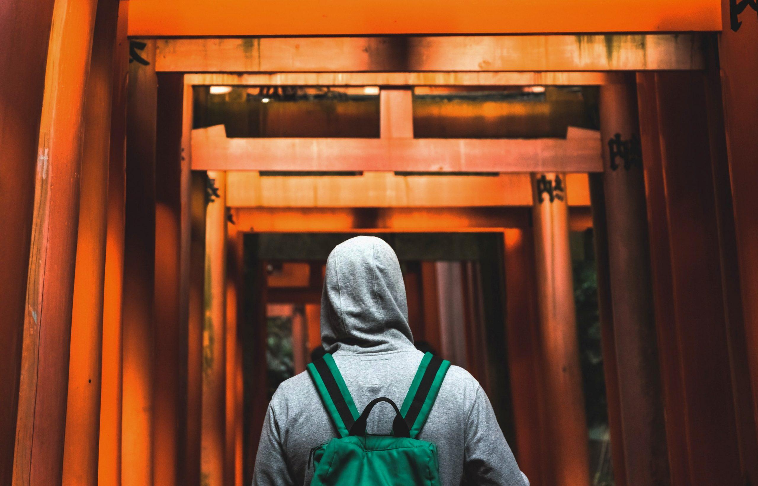 Man walking through a tunnel