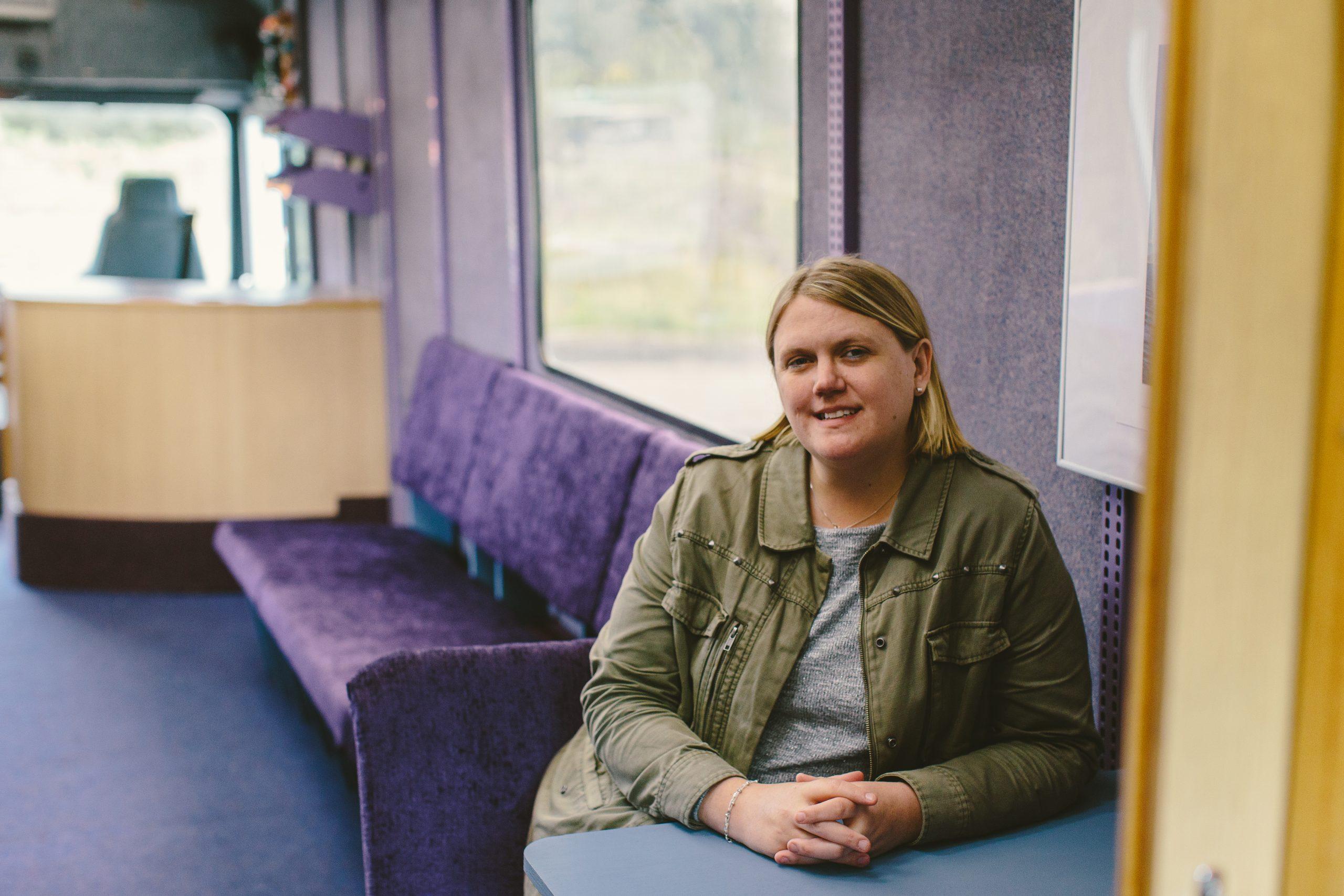 Emma sat inside the Big Blue Bus