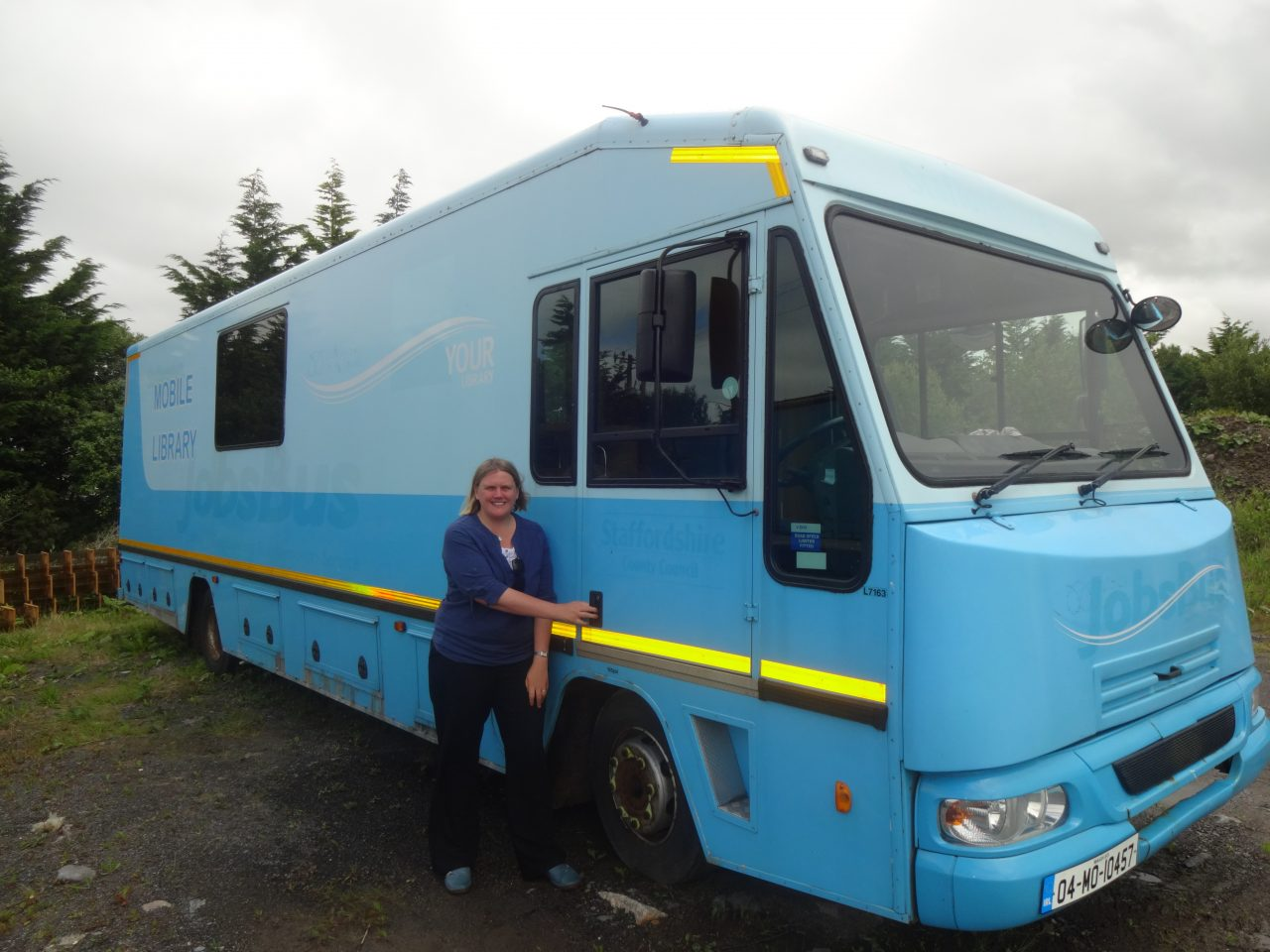 Emma by the Big Blue Bus before it's been refurbished